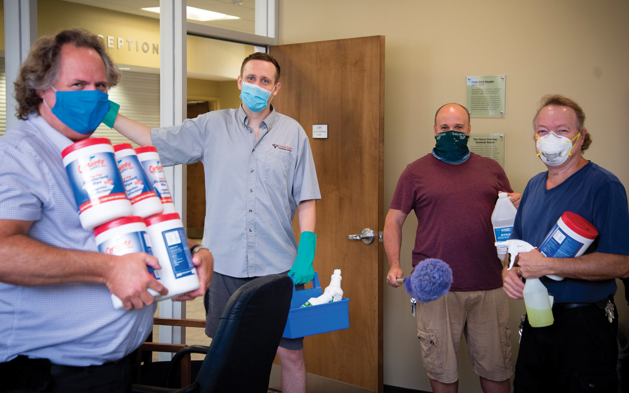 Conrad Grebel University College custodians Paul Penner, Levi Flaming, Peter Hart and Devon Grainger return to work Aug. 4 to prepare for residence students to return to campus in September. — Conrad Grebel University College