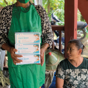Rice miller Daw San Thwin and her staff received protective equipment from MEDA in Myanmar. — Mennonite Economic Development Associates
