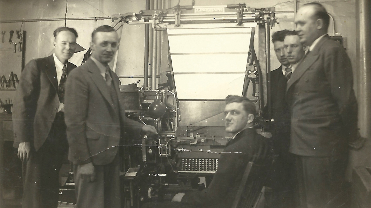 Employees in the print shop of Herald Publishing Co., publisher of Mennonite Weekly Review, 1938. — Mennonite Weekly Review
