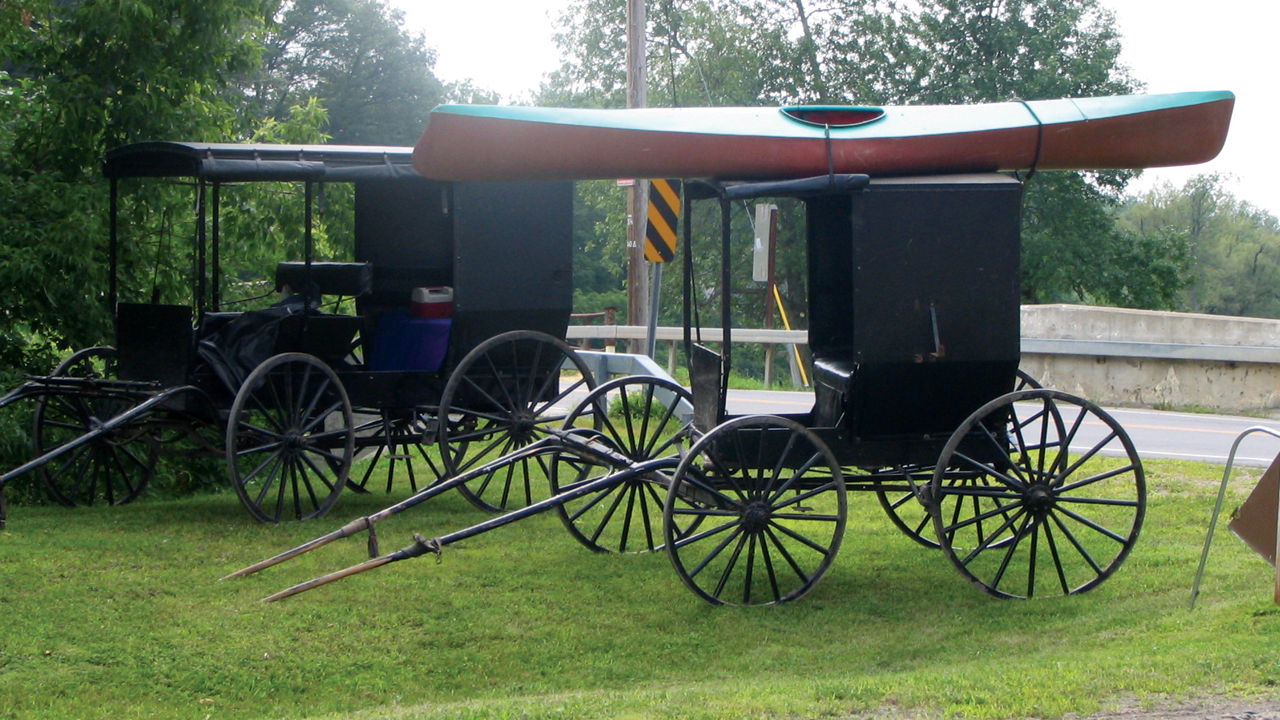 A kayak sits on a Swartzentruber Amish buggy during a fishing outing in New York. The Swartzentrubers have established a number of new settlements in New York since 1974, with a new one going in north of Albany last spring. Among the most conservative Amish groups, Swartzentruber Amish do not use reflectors or slow-vehicle orange triangles on their black buggies. — Karen M. Johnson-Weiner, SUNY Potsdam