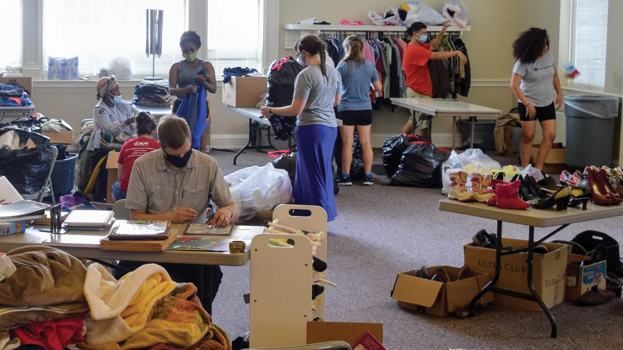 Youth from Mountville Mennonite Church sort supplies that are arriving at Trinity Lutheran Church — Andrew Mashas/EMM