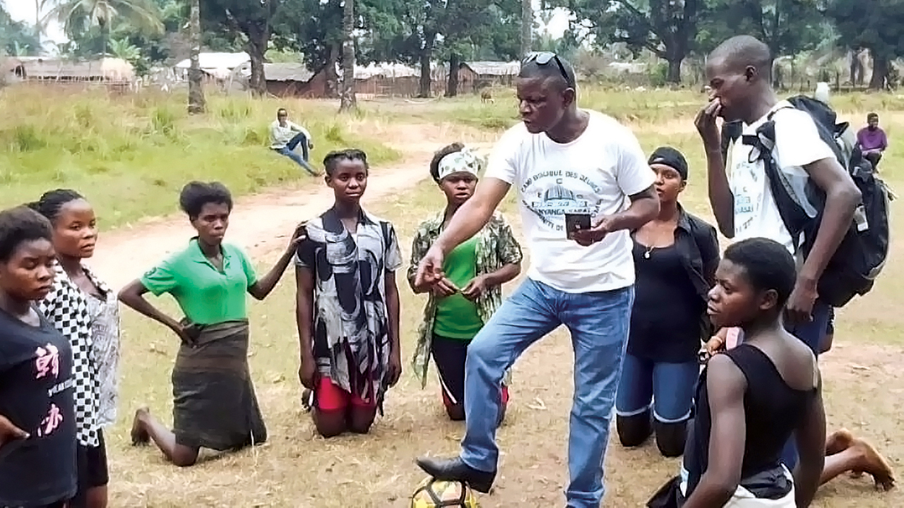 Robert Irundu coaches some members of the women's soccer team at the Bible camp in Nyanga, Democratic Republic of Congo. — Africa inter-Mennonite Mission/Mennonite Mission Network