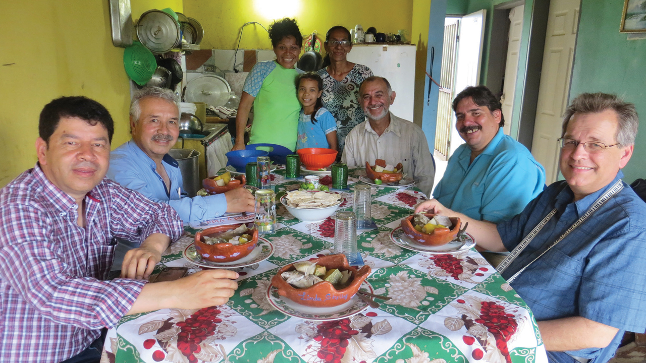Erwin Mirabal, second on the right, hosts a partnership visit in 2018 in Venezuela along with Yermanda Acosta, Verdany Acosta, Darlenis Estaba de Bauza and Euclides Bauza from the Comunidad de Paz church on Isla Margarita. Visitors include Oscar Herrera and Carlos Moreno from the missions committee of the Colombia Mennonite Church, left, and David Boshart from Central Plains Mennonite Conference, right. — Linda Shelly