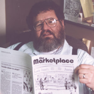 Wally Kroeker checking if any typos appeared after The Marketplace was printed in 1995. — Wally Kroeker