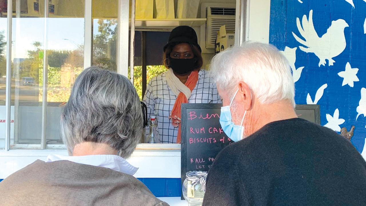 Kabibi Bamuamba serves customers at San Antonio Mennonite Church's new Café Cotidiano coffee trailer. — Katie Best/San Antonio Mennonite Church