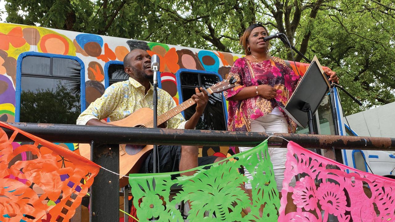 Deo and Kabibi Bamuamba sing in an outdoor community gathering space at San Antonio Mennonite Church. — Katie Best/San Antonio Mennonite Church