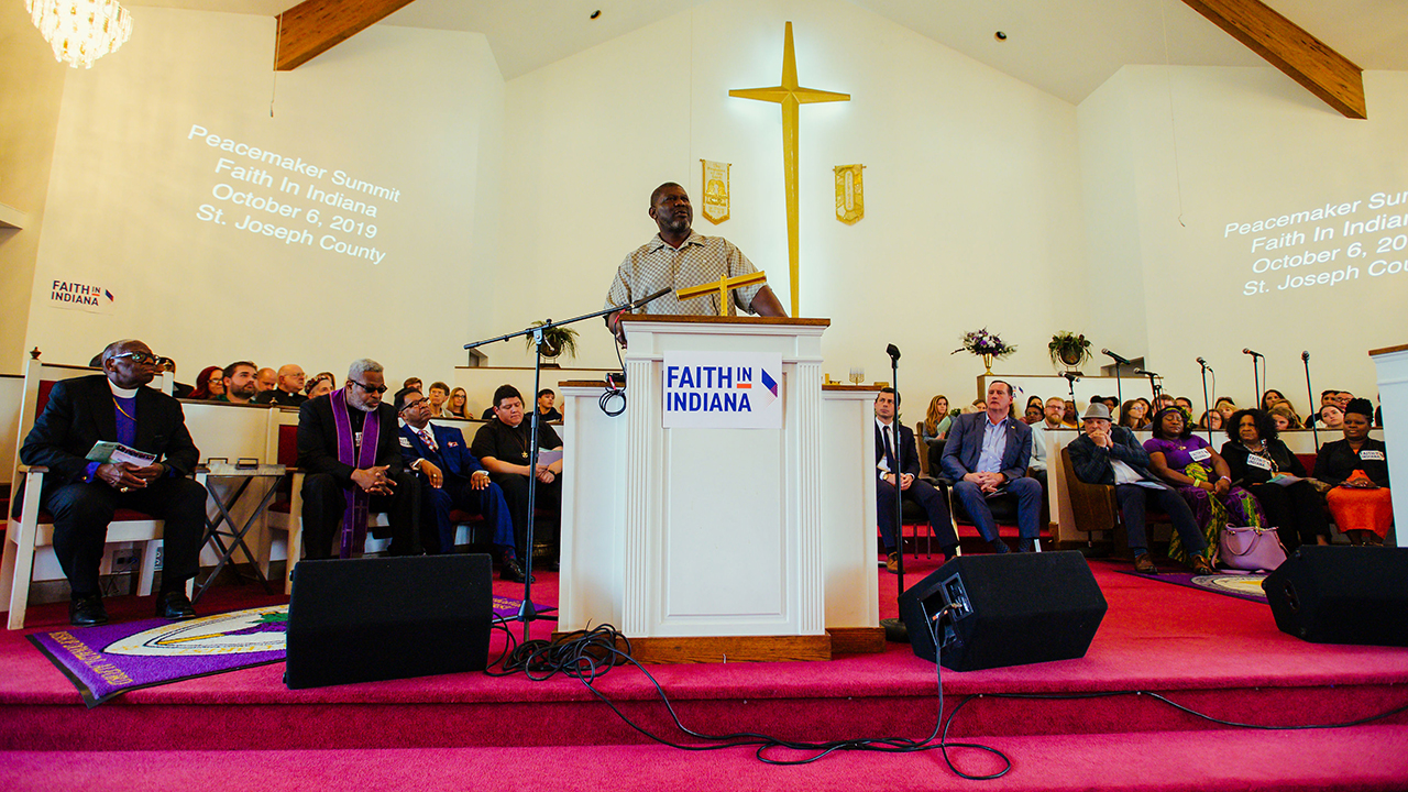 Tyree Bonds, brother of Eric Logan, killed by a South Bend police officer, addresses the Peacemaker Summit organized by Faith in Indiana as public officials and clergy listen on Oct. 6, 2019. — Adam Raschka