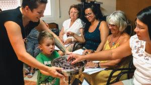 Alisha Garber and son Asher share communion with members of the Mennonite Evangelical Community of Barcelona. — Joshua Garber