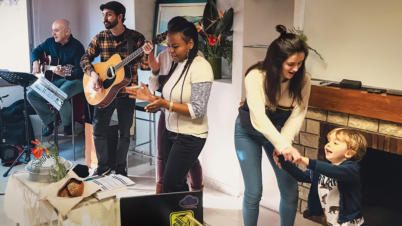 Joshua Garber, second from left, and church youth lead worship at a gathering of the Mennonite Evangelical Community of Barcelona. — Alisha Garber