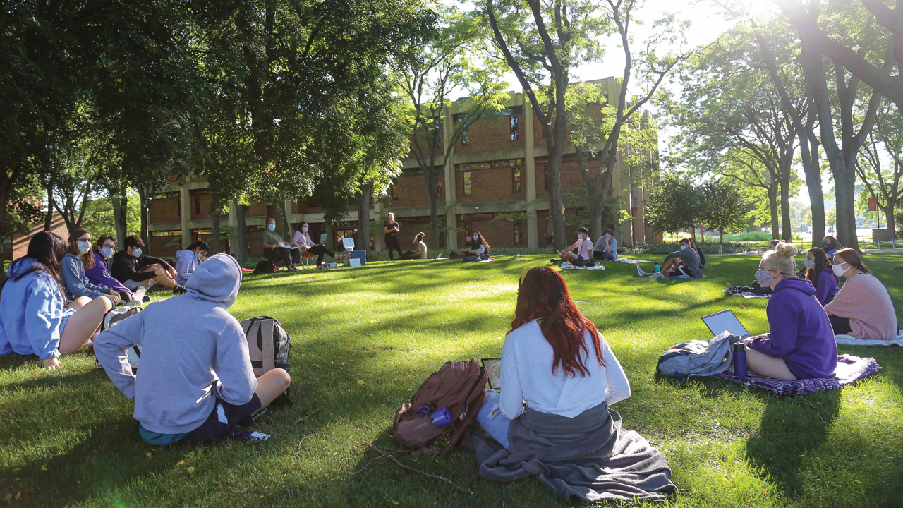 Goshen College students attend a first-year Identity, Culture and Community class outdoors in August. The college has erected several tents around campus for holding classes outdoors as much as possible. — Brian Yoder Schlabach/Goshen College
