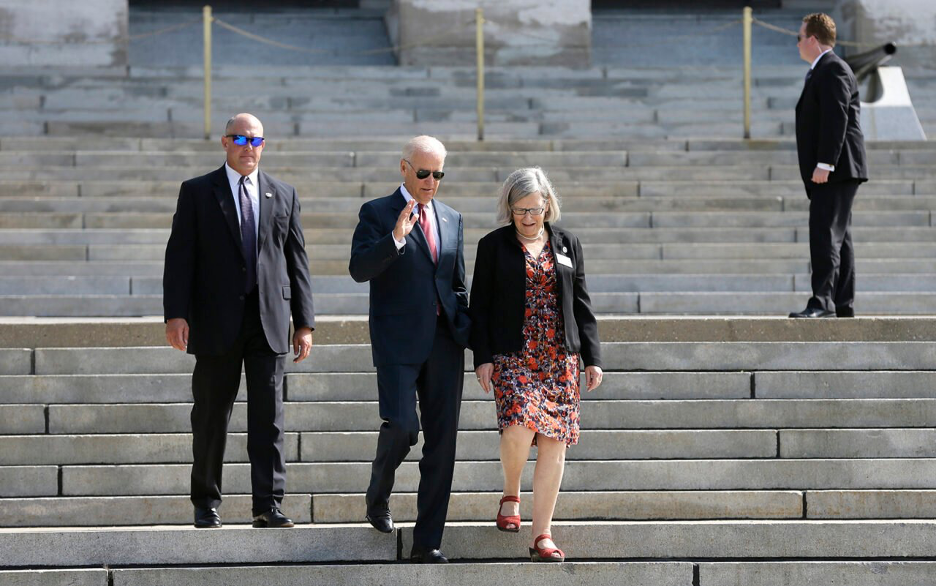 Vice President Joe Biden walks with Sister Simone Campbell, right, before the start of the Nuns on the Bus tour, on Sept. 17, 2014, at the Statehouse in Des Moines, Iowa