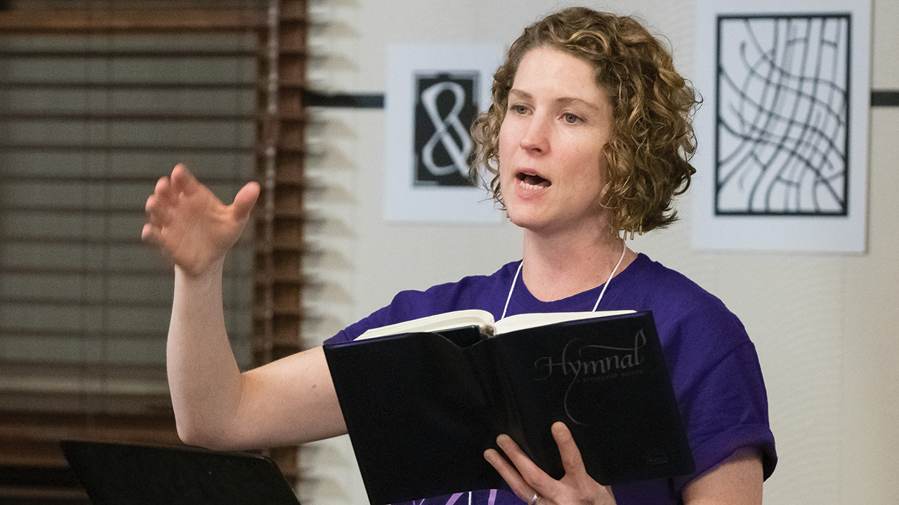 Katie Graber, intercultural worship editor for the Mennonite Worship and Song Committee, leads singing during a Worship and Music Leaders Retreat at Laurelville retreat center in Pennsylvania in January 2020. — Kreg Ulery