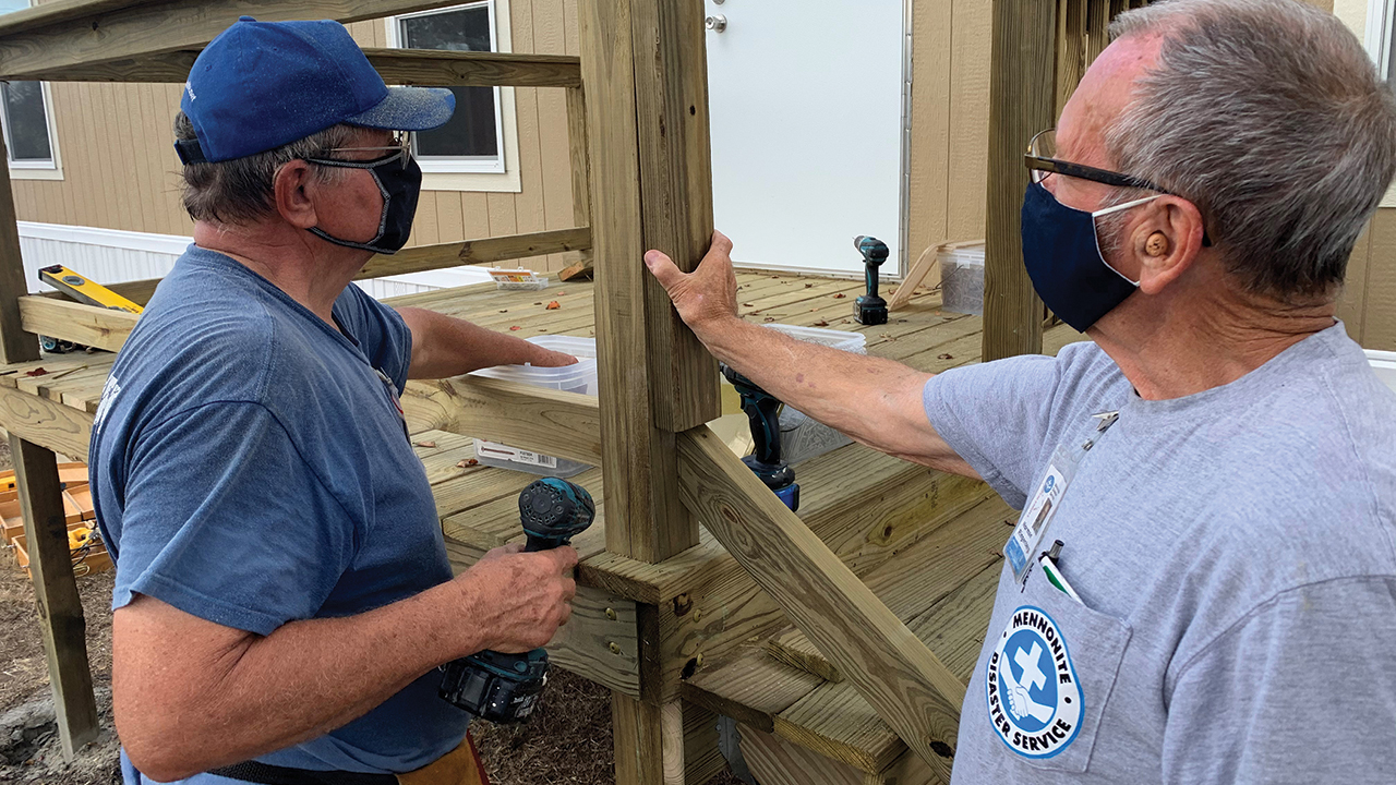 Mennonite Disaster Service recreational vehicle volunteers Bob Ratzlaff and Norm Ringenberg build a deck Nov. 11 for a home in Aransas Pass, Texas. — Mennonite Disaster Service