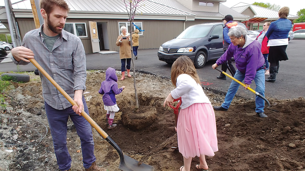 Members of Assembly Mennonite Church in Goshen, Ind., plant trees as part of the church's Sunday school time on May 12, 2019. — Glenn Gilbert/Assembly Mennonite Church