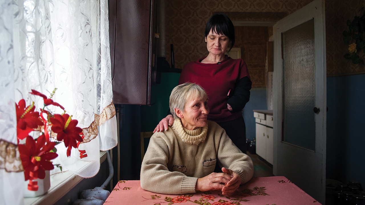 In 2013, in Nikopol, Ukraine, Natalia Mezentseva (standing) of MCC partner New Life meets with Lubov Yarchuk. New Life meets basic needs of those displaced by conflict, or struggling with issues like HIV, addiction or homelessness. — Matthew Sawatzky/MCC