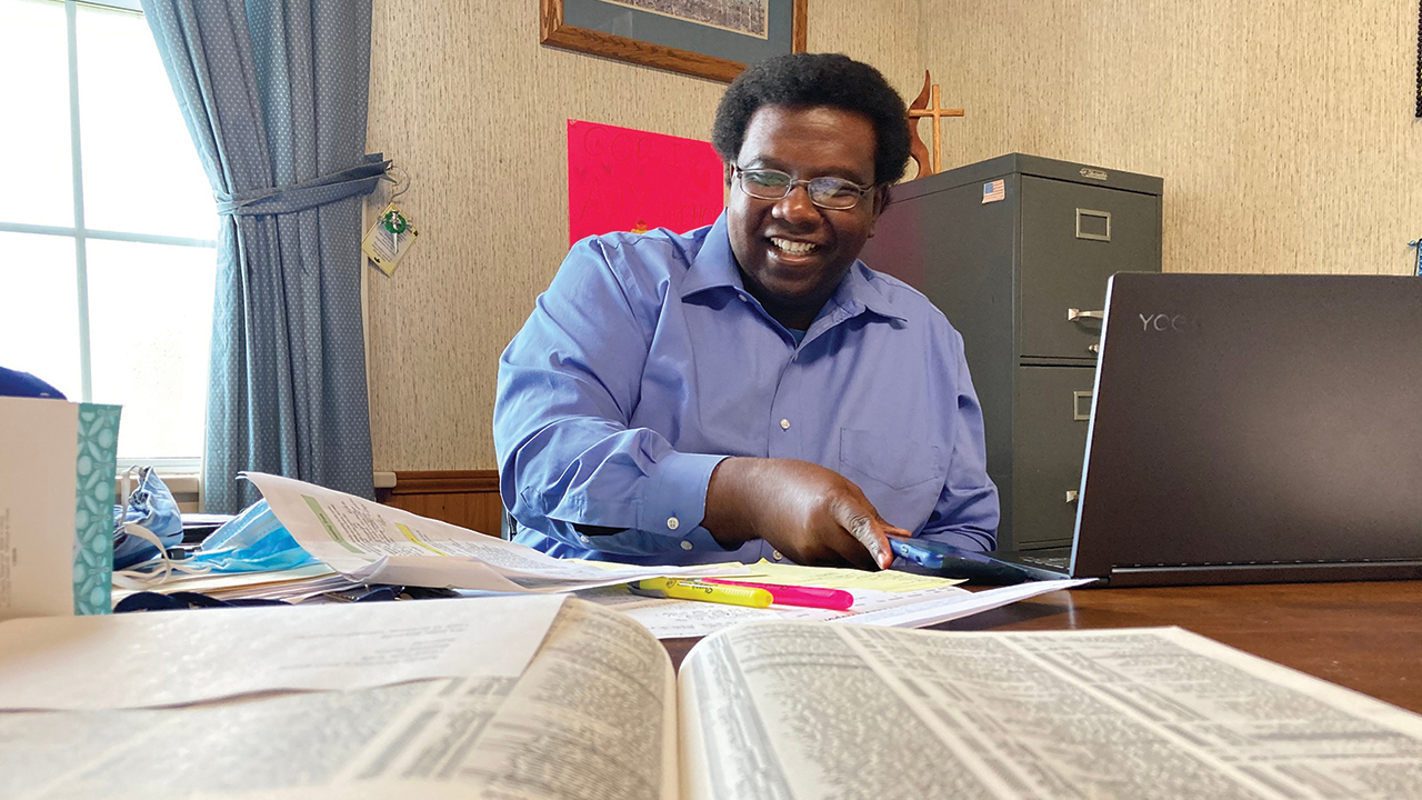 Aldana Allen works in his office at Providence United Methodist Church. — Yonat Shimron/RNS