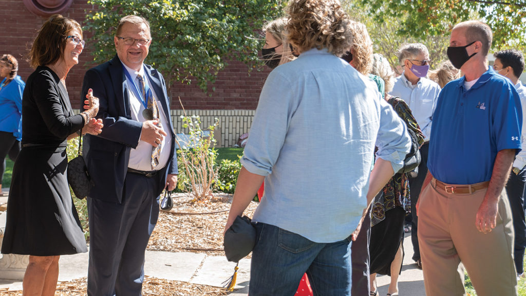 Tabor College President Jules Glanzer and his wife, Peg, greet guests after commencement Oct. 11 during homecoming weekend. Spring commencement activities were delayed to the fall due to COVID-19. — Tabor College