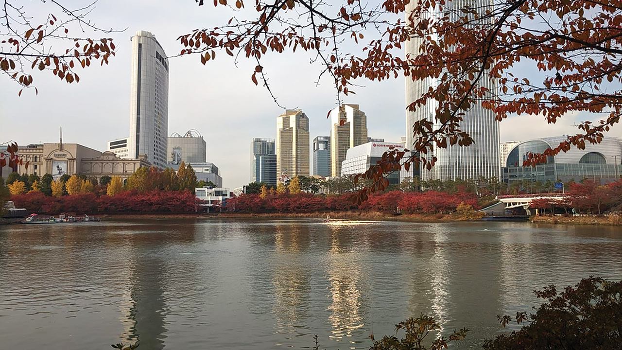 Skyscrapers of Seoul, South Korea, rise behind Seokchon Lake, south of the Han River, which bisects the city. The Lotte Tower, at right, is the world's fifth-tallest building. — Lane Miller