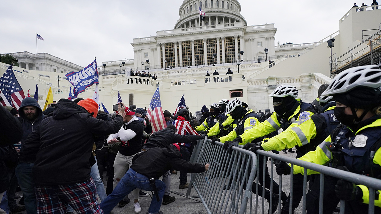 Trump supporters try to break through a police barrier on Jan. 6 at the Capitol in Washington. — Julio Cortez/AP