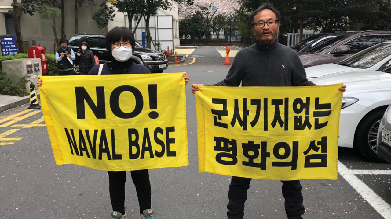 Song Kang Ho, right, protests construction of a naval base on Jeju Island in South Korea with Ryu Bok Hee in early 2020. Ryu was also arrested for entering the base, but received a lesser sentence because she did not cut the fence. — The Frontiers