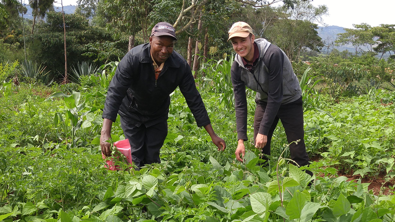 Ben Brockmueller, right, served in Kenya with Mennonite Central Committee's SALT (Serving and Learning Together) program in 2017-2018. At left is Joel Mutua, one of the lead farmers and agricultural educators in his Kenyan community. — Arnold Mwatha Maingi