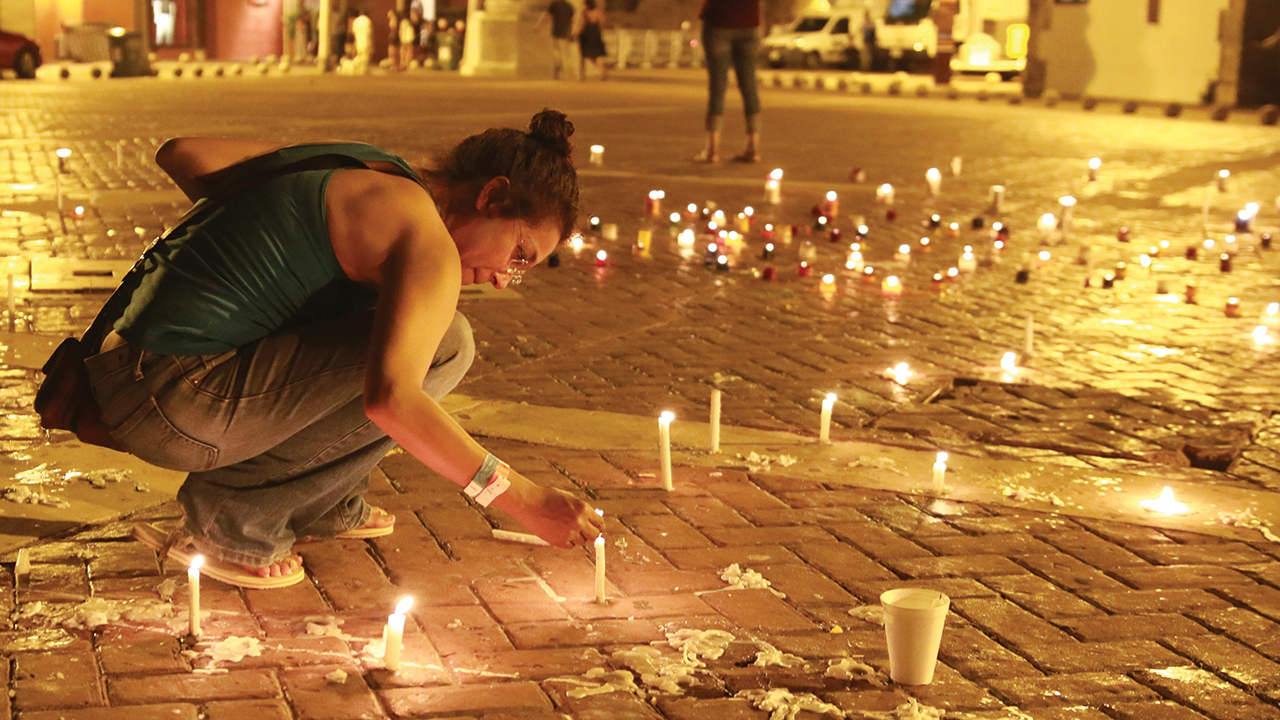 Candles mark the hope many Colombians had when a peace accord was signed in 2016. — Presidencia El Salvador/Creative Commons
