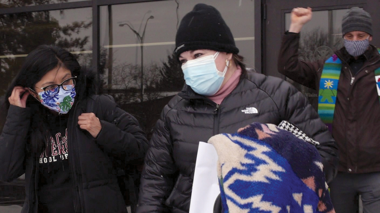 Edith Espinal, center, departs the Immigration and Customs Enforcement office in Columbus, Ohio, after leaving her sanctuary status the morning of Feb. 18 at Columbus Mennonite Church. She was accompanied by her attorney Lizbeth Mateo, left, Pastor Joel Miller, right, along with other members of the church. — Elisa Leahy