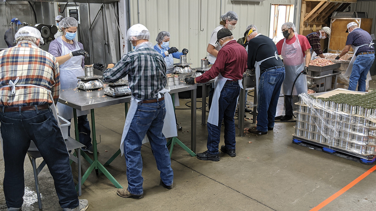 Volunteers process meat on Nov. 11 at the Mennonite Central Committee Material Resources Center in North Newton, Kan. — Heidi Huber/MCC