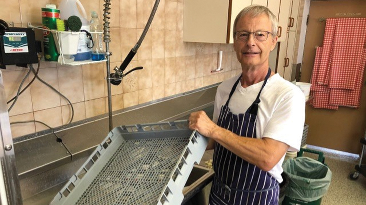 Bob Ratelle does clean up in the kitchen at Scott St. Church in St. Catharines, Ont., after making meals made possible by support from the MDS Canada Spirit of MDS Fund. — Mennonite Disaster Service