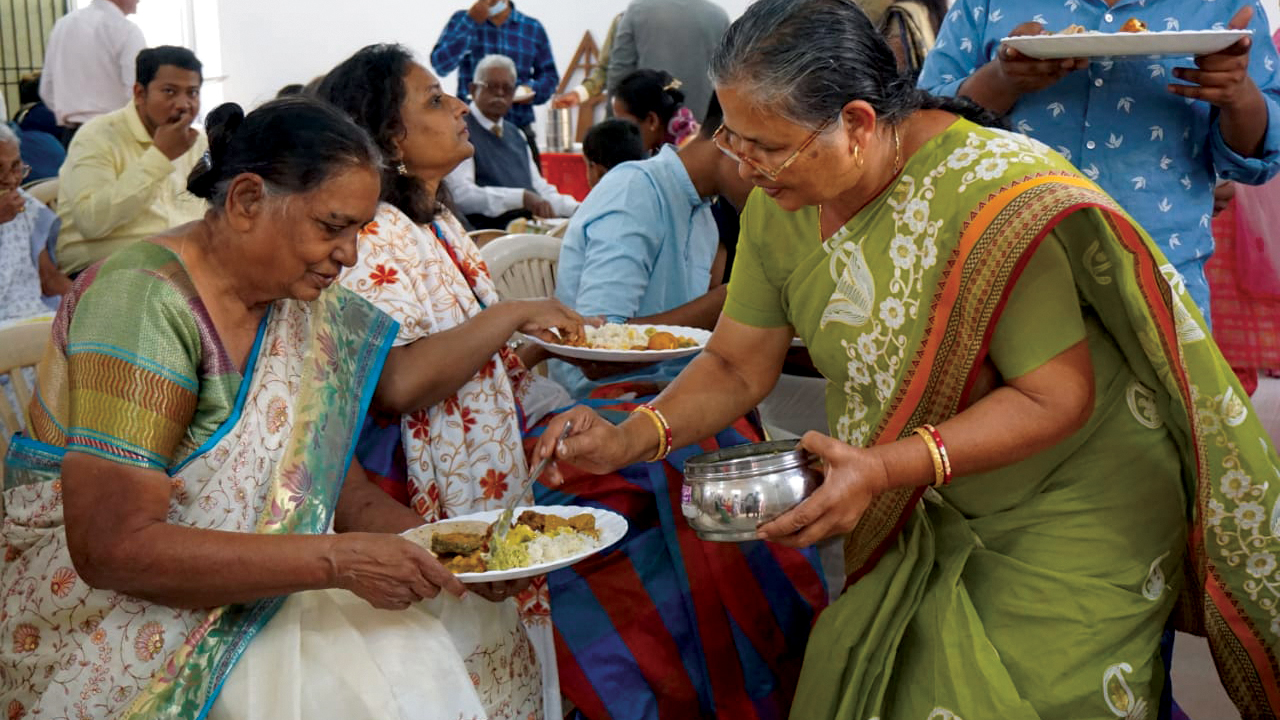 Members of Rajnandgaon Mennonite Church in India share a meal after their Anabaptist World Fellowship Sunday service. — Preshit Rao/MWC