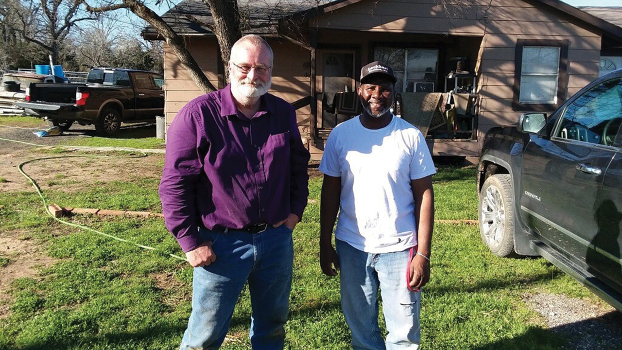 MDS volunteer Doug Casey, left, shares a smile with Casey Waites of Bastrop, Texas, after restoring water in his home. — Mennonite Disaster Service