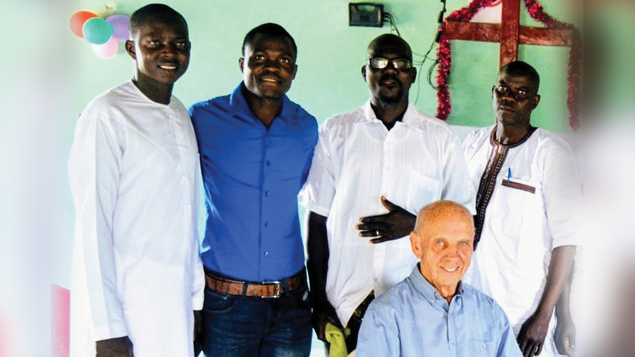 Beryl Forrester, seated, with Mennonite Church West Africa pastors, from left, Adriano MBackeh, Daniel Djin-ale, Gibby Mane and Sangpierre Mendy. — Eastern Mennonite Missions