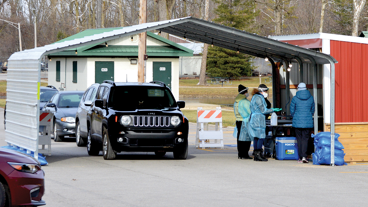 Cars line up at Shanklin Park in Goshen, Ind., for COVID-19 testing from the Center for Healing & Hope. — Missy Schrock
