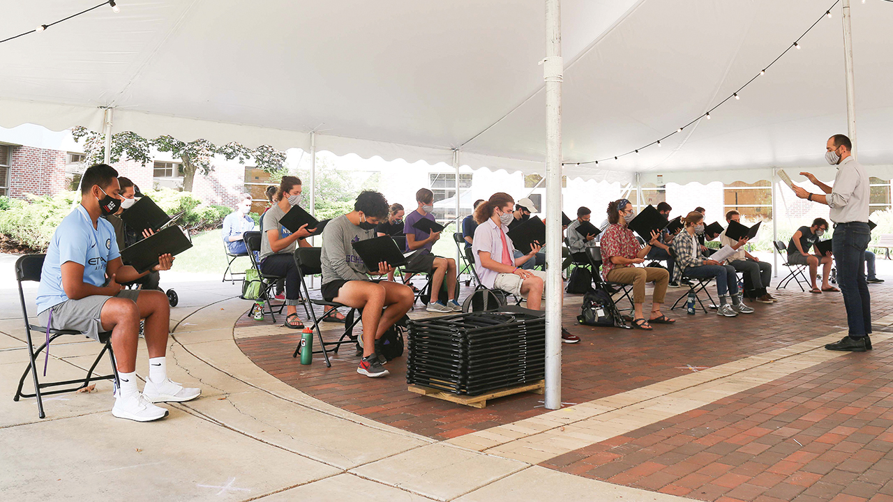 Goshen College's Vox Profundi choral ensemble rehearses outdoors last fall. — Brian Yoder Schlabach/Goshen College