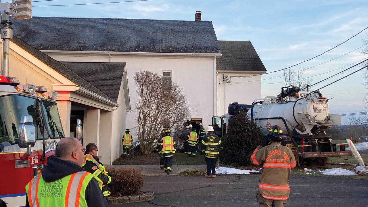 Numerous fire and police personnel were on the scene at West Swamp Mennonite Church on March 9 when a truck lost control and ran into the church building. — Sue Conrad Howes/Mosaic Mennonite Conference