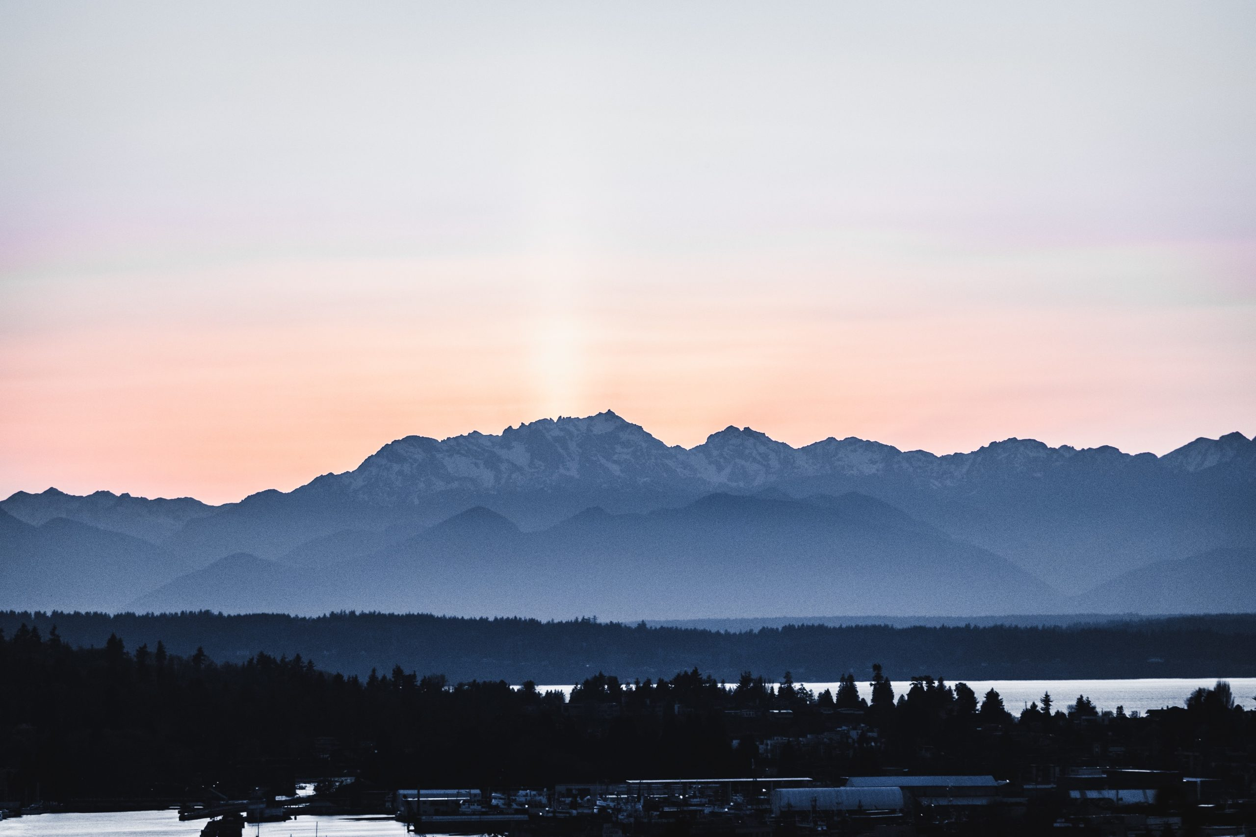 Sunset over the Olypmic Mountains by David H on Unsplash.com