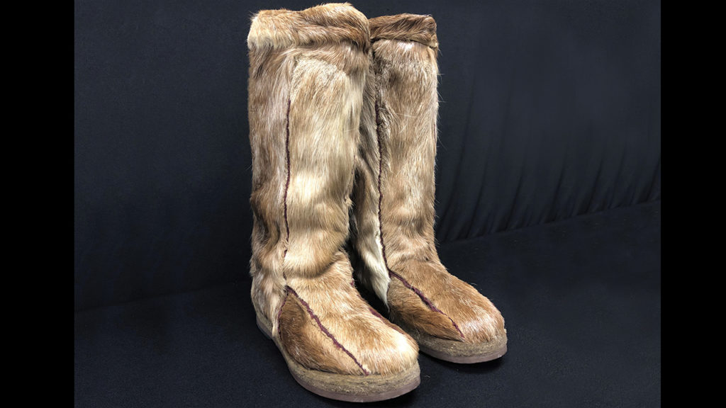 Daniel Driedger's fur boots highlight his experiences as a Mennonite who served in the German military in the Second World War and was exiled to Siberia thereafter. — Mennonite Heritage Village