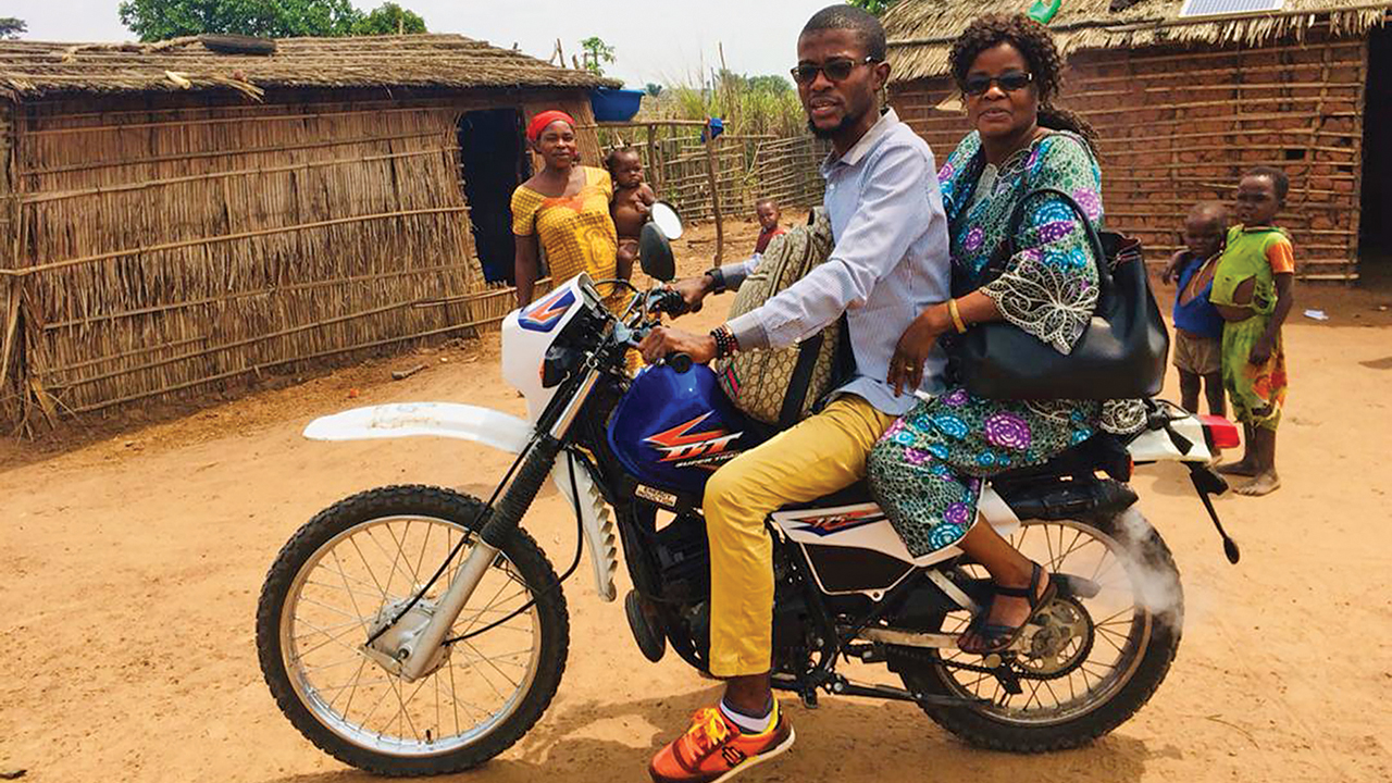 Bercy Mundedi and her son, Serge, traveled by motorbike to encourage people isolated by COVID-19 restrictions. — Mennonite Mission Network