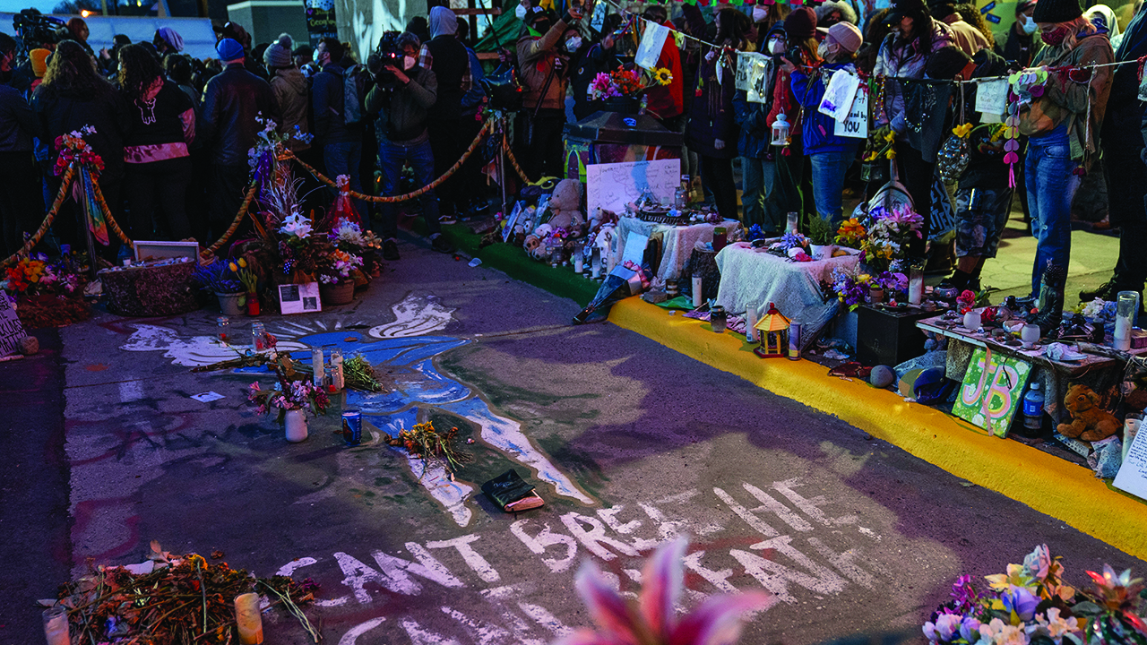 Demonstrators gather around the pavement where George Floyd was murdered to celebrate the conviction of former Minneapolis police officer Derek Chauvin on April 20 in Minneapolis. — John Minchillo/AP