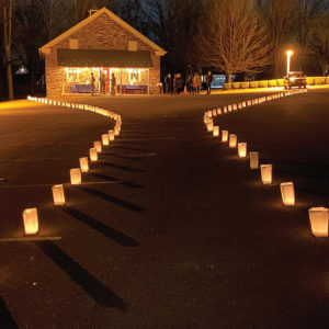 Luminaries lit a path that ended at the historic Salford schoolhouse, built in 1883, where a space for prayer was available. Participants could reflect with art, light a candle and write a prayer to hang on a prayer wall. The prayer wall tags included names of people who died from COVID-19, as well as hopes for the future. — Sondi Good Alderfer