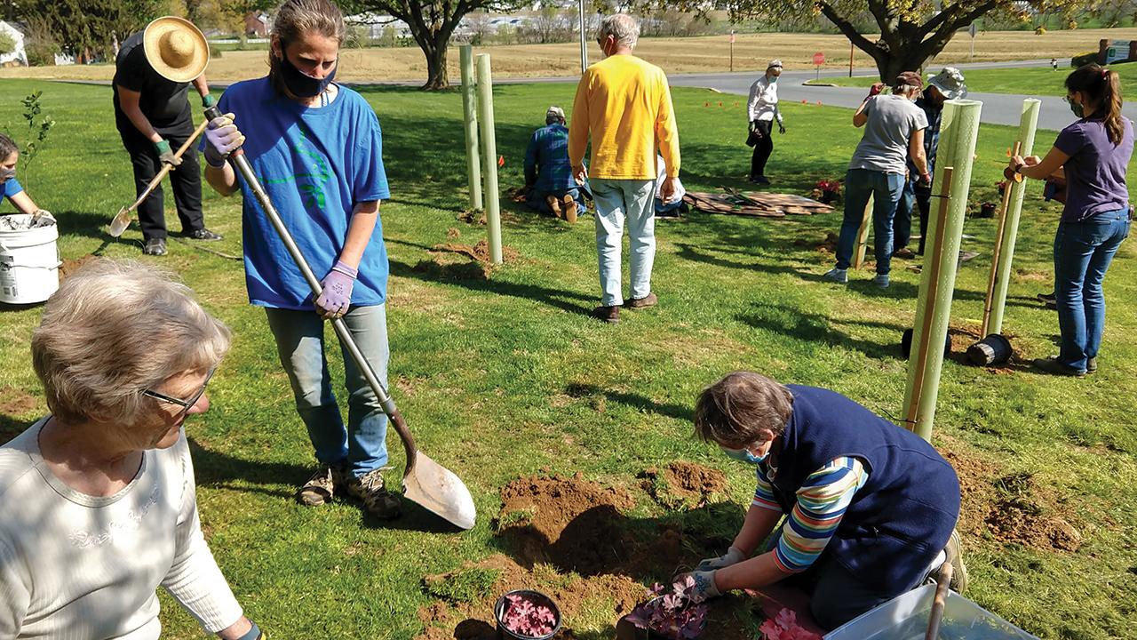 Members of Landisville Mennonite Church in Pennsylvania planted a native species demonstration orchard and extended their memorial garden in April. — Chris Fretz/Mennonite Men