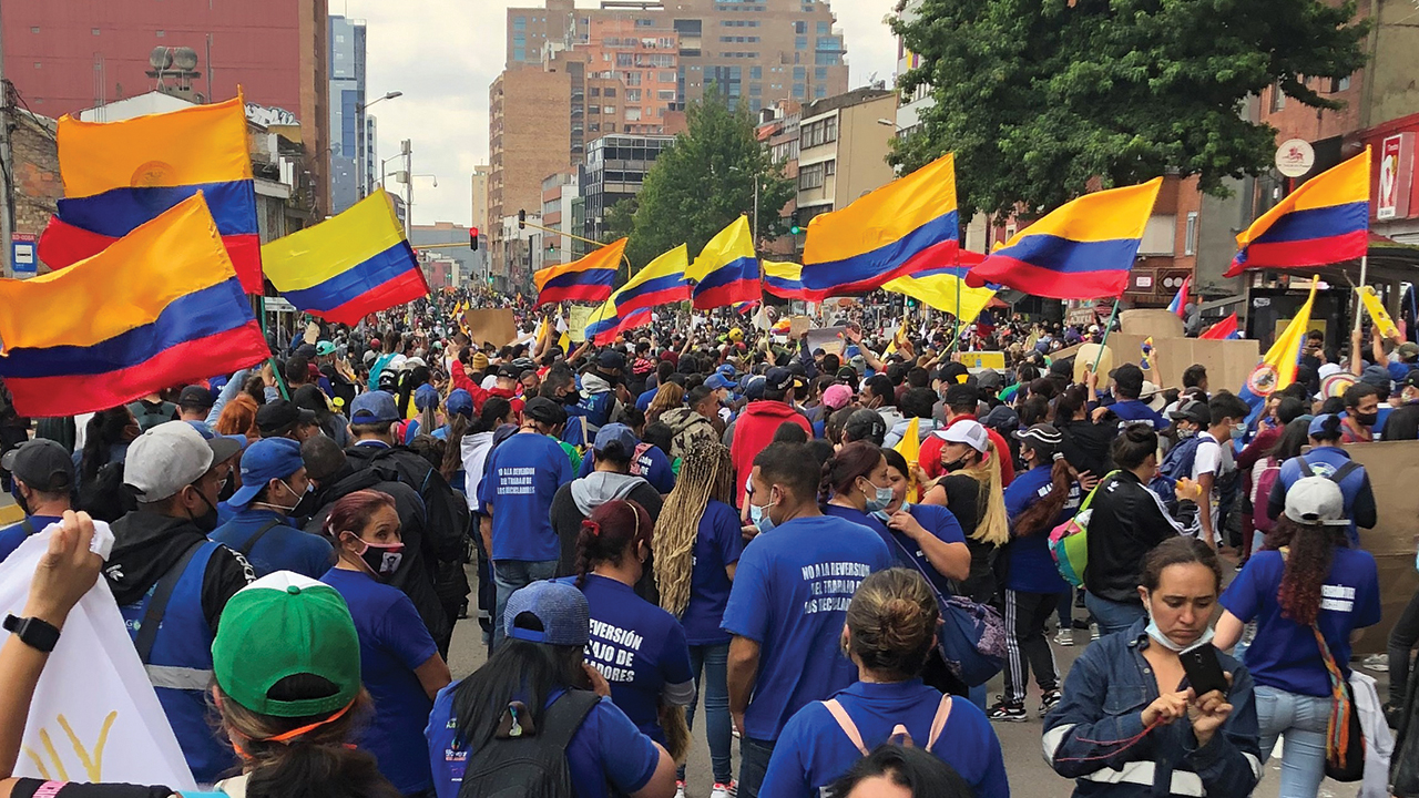 Representatives of JustaPaz — among other citizens, human rights workers and labor union members — join demonstrations in Bogotá, Colombia. — Rebekah York/MMN