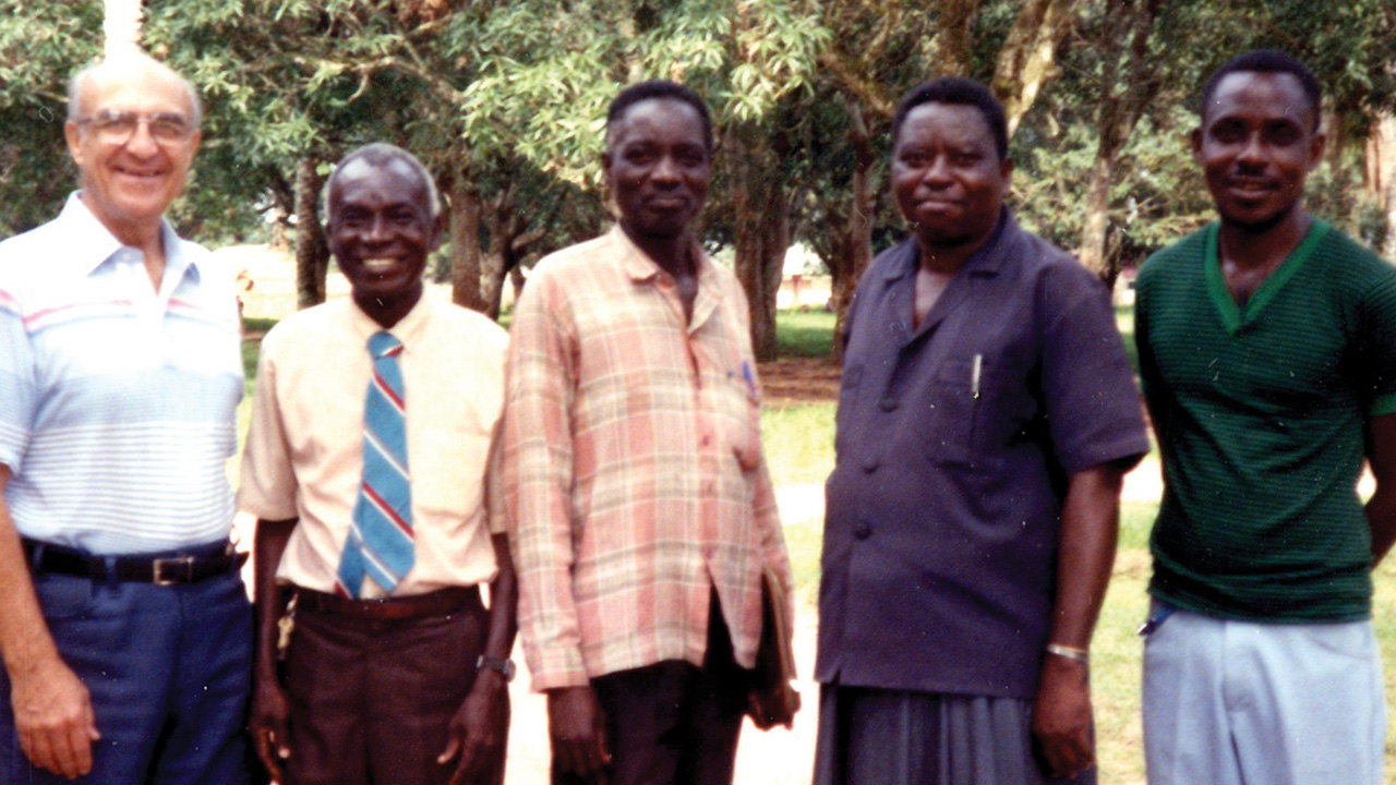 Earl Roth, left, greets Chief Nyanga, second from right, and other friends on an administrative trip to Congo in 1993. — Mennonite Church USA Archives
