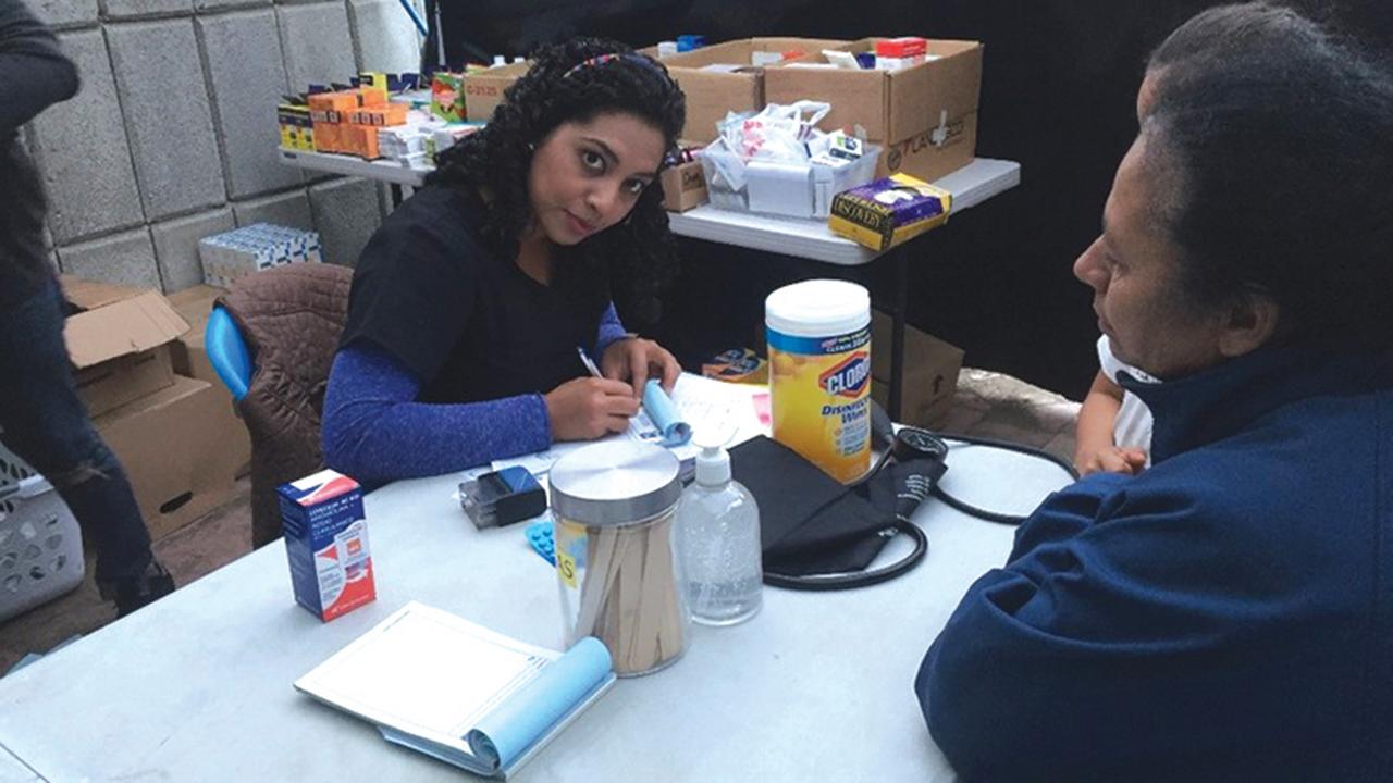 Ela Castro, a 2019-20 YAMEN participant, works in January 2020 at Casa del Migrante in Guatemala City. — Samuel Gaitan/Casa del Migrante
