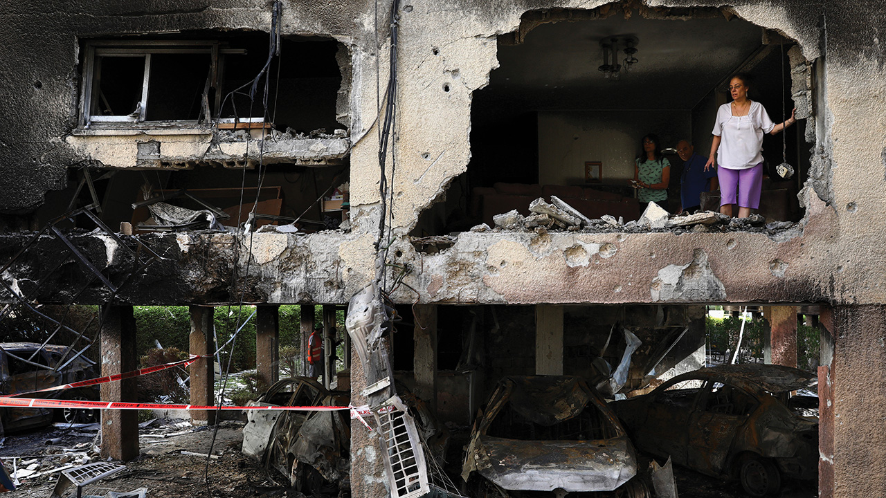 Members of the Sror family inspect the damage of their apartment in Petah Tikva, Israel, after it was hit by a rocket fired from the Gaza Strip on May 13. — Oded Balilty/AP