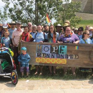 Members of two Winnipeg, Man., congregations — Hope Mennonite Church and River East Church, a Mennonite Brethren congregation — gather after participating in Winnipeg's Pride parade in 2019. — Hope Mennonite Church
