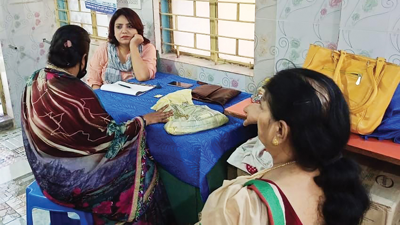 (Below) Counselor Mily Chatterjee, facing camera, listens to Anju Shaw, left, during a counseling session through MCC partner Barrackpore Avenue Women's Cultural & Social Welfare Society. — Barrackpore Avenue