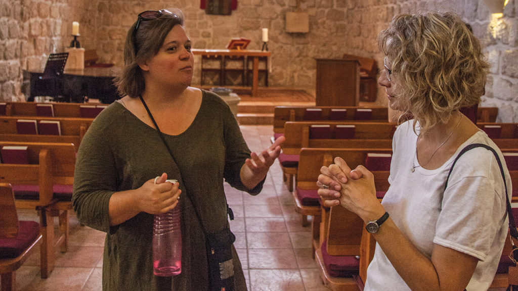 Amy Yoder McGloughlin talks with a member of Redeemer Lutheran Church in Jerusalem after their English-speaking worship service on Aug. 16, 2015. — Lowell Brown