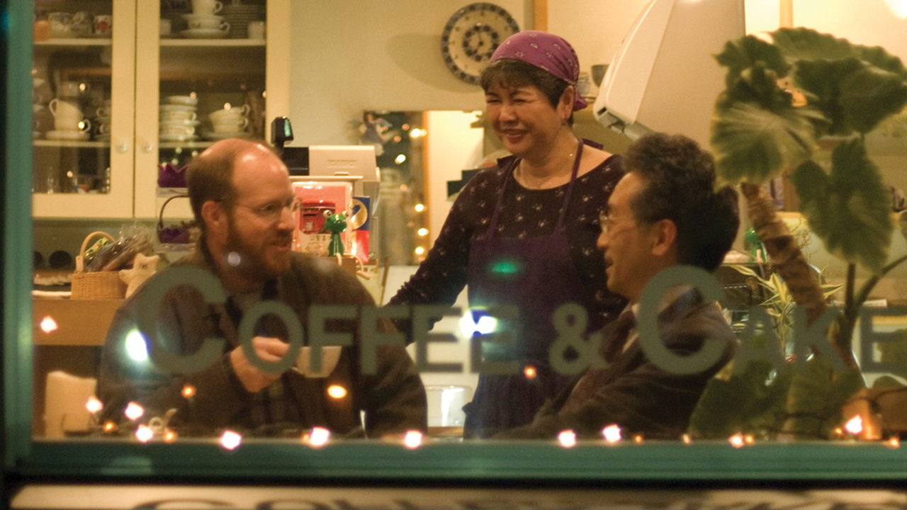 Above: Mike Sherrill visits with Serita Sensei, pastor of Grace Mennonite Church, and his wife, Kyoko San, in the café the couple ran at the Fukuzumi Mennonite Center in Sapporo, Japan, in 2006. Serita Sensei continues as pastor; both he and Kyoko San retired from the café and closed it a few years ago. — David Fast/MMN