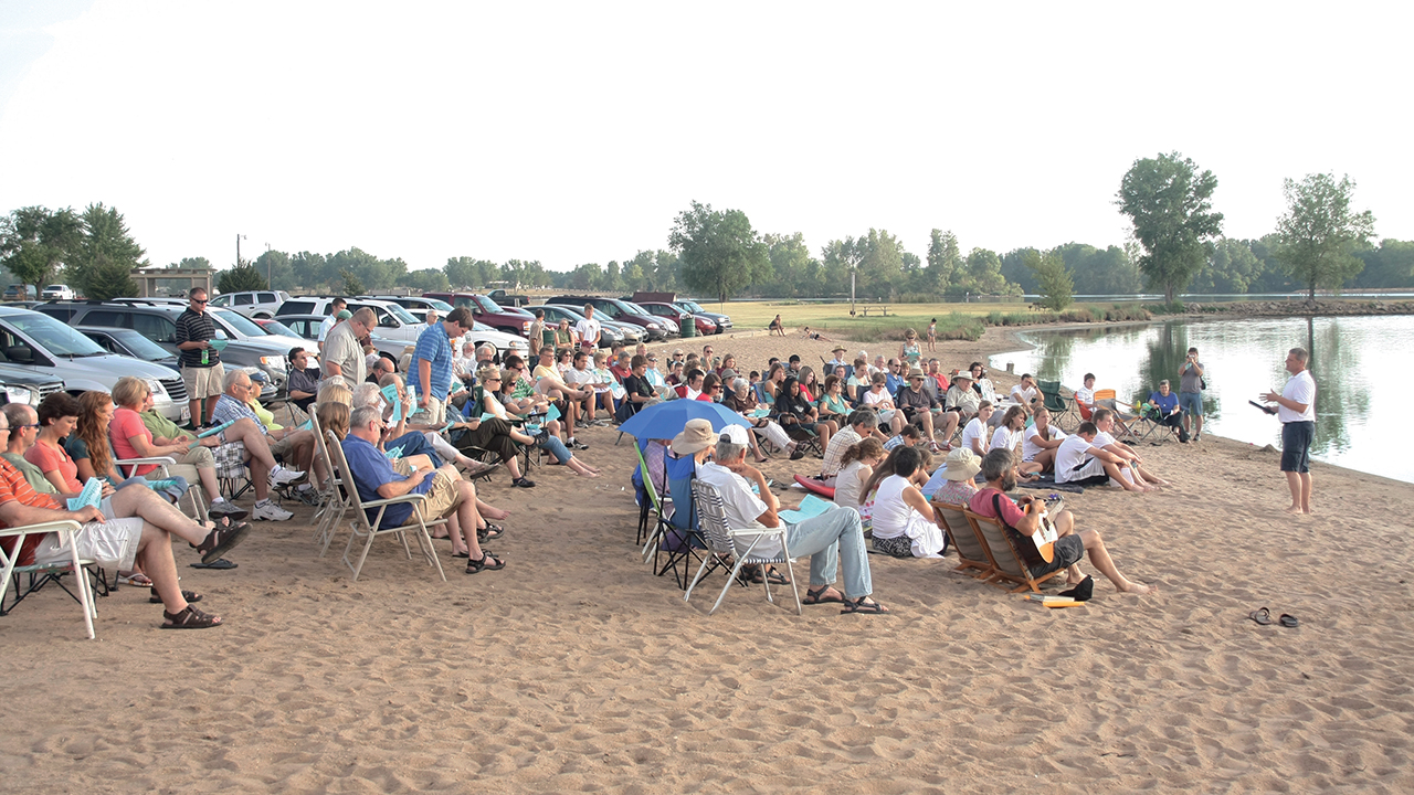 Members of First Mennonite Church in Newton, Kan., gathered at East Lake for a baptism service in 2011. — Rod Wedel